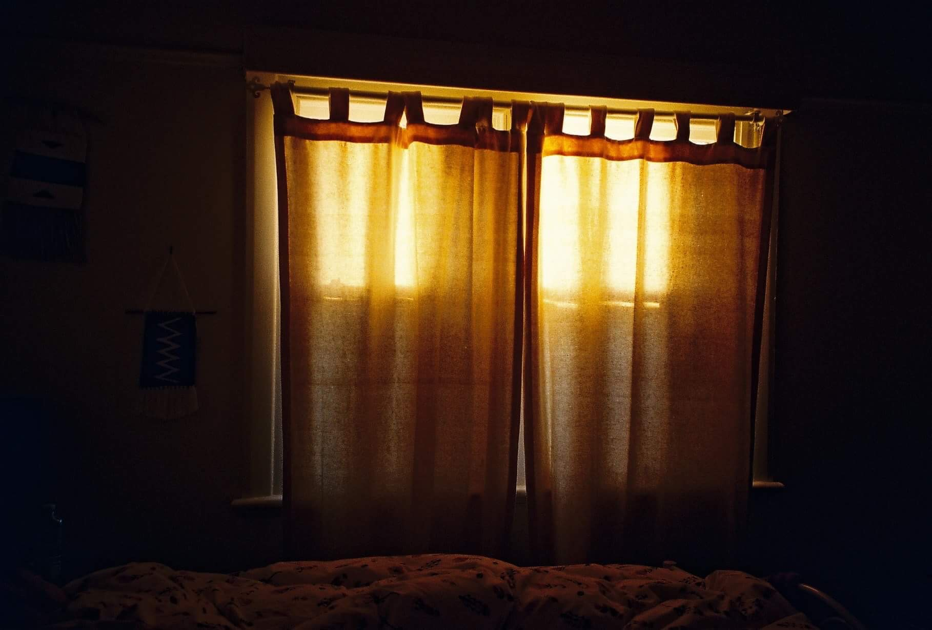 The light shining through the bedroom window